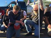 Eamon Daley (L), 28, and other supporters of President Donald Trump kneel to pray outside Jones Diner in Towanda, Pennsylvania