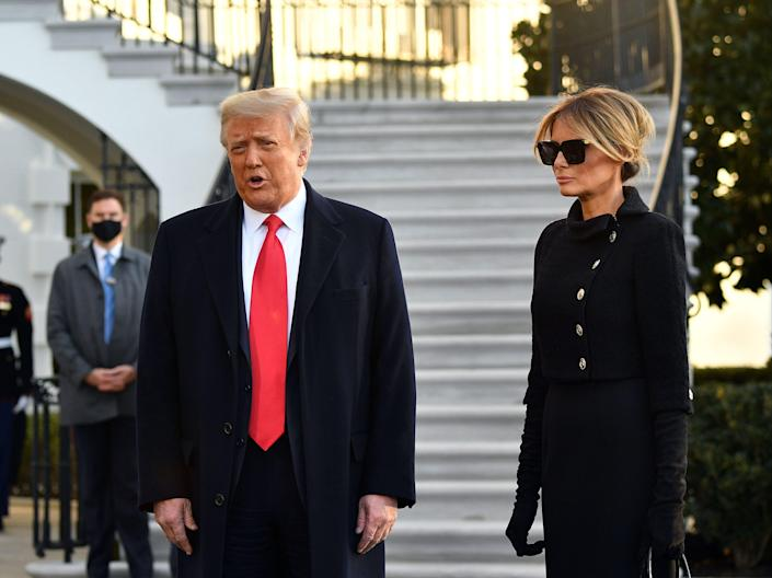 Donald Trump and First Lady Melania depart the White House for the last time on the morning of Inauguration Day. The couple is eschewing the tradition of meeting the incoming first family and will not attend president-elect Biden's inauguration. Mrs Trump has not given incoming first lady, Dr Jill Biden, a tour of the private residence and has reportedly not been in touch with her at allAFP via Getty Images