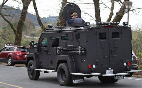 An armored vehicle arrives at the Veterans Home of California in Yountville - Credit: AP