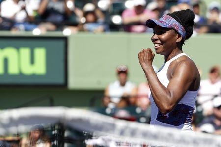 Mar 25, 2018; Key Biscayne, FL, USA; Venus Williams of the United States celebrates after match point against Kiki Bertens of the Netherlands (not pictured) on day six of the Miami Open at Tennis Center at Crandon Park. Williams won 5-7, 6-3, 7-5. Geoff Burke-USA TODAY Sports