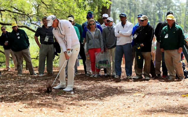 <span>Not out of the woods: Danny Willett of England plays a shot from under the trees on the first hole during the first round</span> <span>Credit: Getty </span>