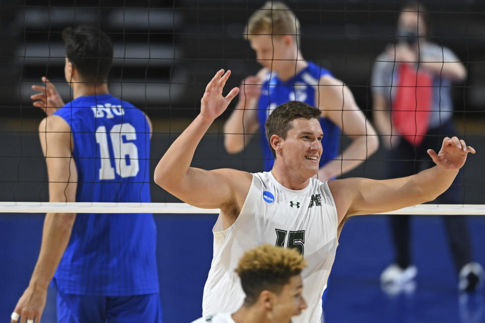Hawaii's Patrick Gasman (15) celebrates after a Hawaii point during the NCAA men's volleyball championship match against BYU, Saturday, May 8, 2021, in Columbus, Ohio. (AP Photo/David Dermer)