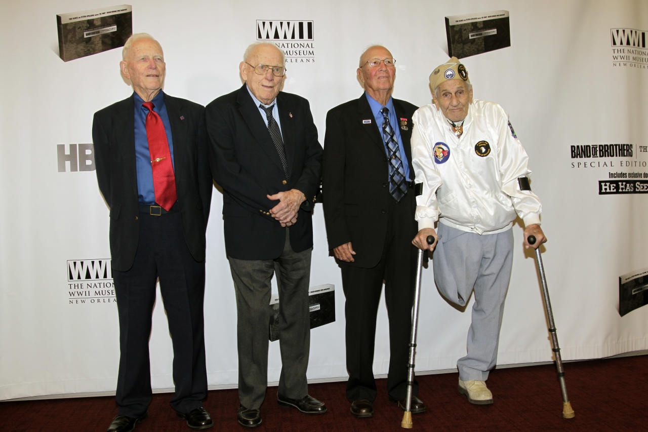 "In this image released by HBO, WWII veterans, from left, Sid Phillips, Buck Compton, Bradford Freeman, and William Guarnere pose at the screening of the ""Band of Brothers"" and ""The Pacific"" special edition DVD set at the National WWII Museum in New Orleans, Friday, Nov. 11, 2011. (AP Photo/HBO, Bill Haber)"