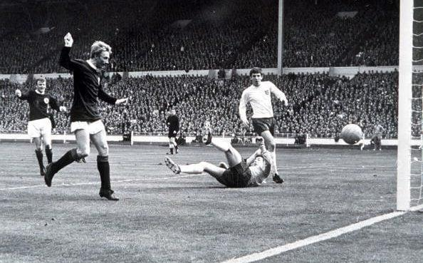 Denis Law beats England goalkeeper Gordon Banks to score the first goal - Bentley Archive/Popperfoto via Getty Images