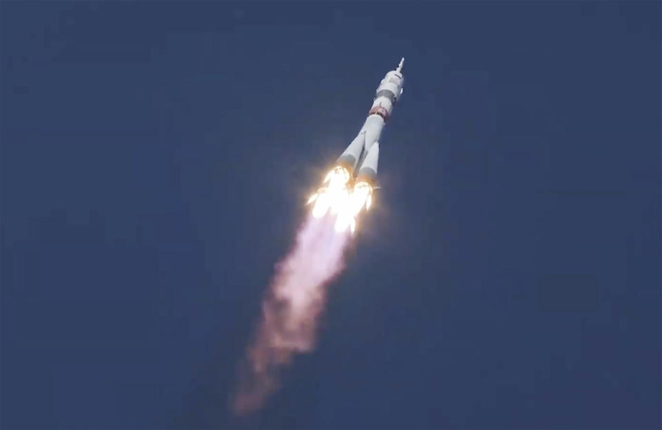 In this image made from video footage released by Roscosmos Space Agency, the Soyuz-2.1a rocket booster with the Soyuz MS-17 space ship carrying a new crew to the International Space Station (ISS), blasts off at the Russian leased Baikonur cosmodrome, Kazakhstan, Wednesday, Oct. 14, 2020. A trio of space travelers has launched successfully to the International Spce Station, for the first time using a fast-track maneuver to reach the orbiting outpost in just three hours. NASA's Kate Rubins and Sergey Ryzhikov and Sergey Kud-Sverchkov of the Russian space agency Roscosmos lifted off as scheduled at 10:45 a.m. (1:45 a.m. EDT, 5:45 a.m. GMT) Wednesday from the Russia-leased Baikonur space launch facility in Kazakhstan for a six-month stint on the station. (Roscosmos Space Agency via AP)