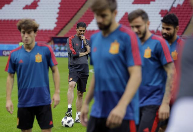 Spain head coach Fernando Hierro watches his players during the official training on the eve of the group B match between Iran and Spain at the 2018 soccer World Cup in the Fisht Stadium in Kazan, Russia, Tuesday, June 19, 2018. (AP Photo/Sergei Grits)