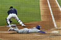 Los Angeles Dodgers' Corey Seager scores past Tampa Bay Rays catcher Mike Zunino during the fifth inning in Game 4 of the baseball World Series Saturday, Oct. 24, 2020, in Arlington, Texas. (AP Photo/Eric Gay)