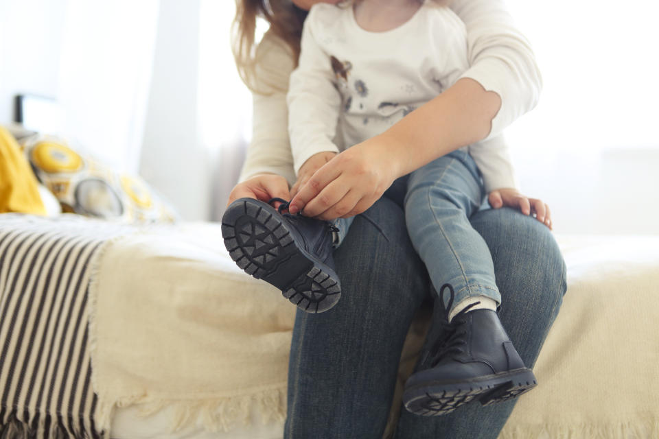 Helping kids learn how to tie their shoelaces has been most challenging, according to a new survey of mums and dads (Getty Images)
