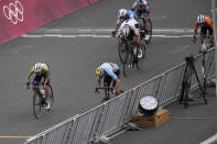 Tadej Pogacar of Slovenia, left, and Wout van Aert of Belgium, battle for a photo finish for silver and bronze medals during the men's cycling road race at the 2020 Summer Olympics, Saturday, July 24, 2021, in Oyama, Japan. (AP Photo/Christophe Ena)