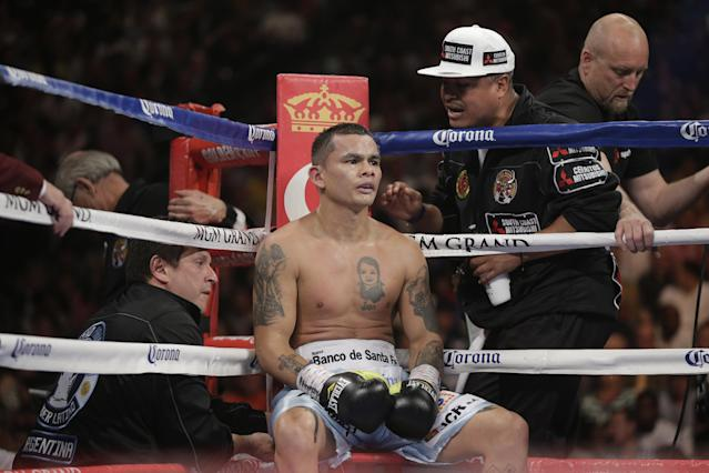 Marcos Maidana, from Argentina, sits in his corner during his WBC-WBA welterweight title boxing fight against Floyd Mayweather Jr. Saturday, May 3, 2014, in Las Vegas. (AP Photo/Isaac Brekken)