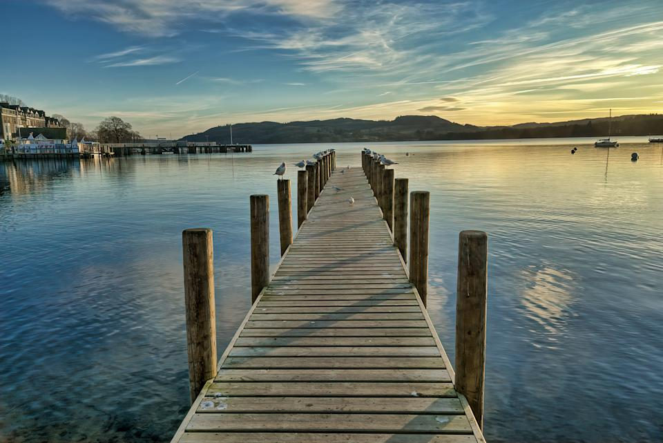 A jetty on Windermere in the English Lake District at sunset.