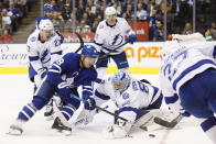 Toronto Maple Leafs left wing Andreas Johnsson (18) handles the puck in front of Tampa Bay Lightning goaltender Andrei Vasilevskiy (88) during the second period of an NHL hockey game Thursday, Oct. 10, 2019, in Toronto. (Cole Burston/The Canadian Press via AP)