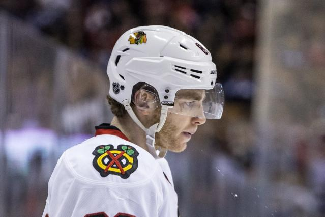 Chicago Blackhawks' Patrick Kane stands on the ice as his team trails 7-3 to the Toronto Maple Leafs during the third period of an NHL hockey game in Toronto on Saturday, Dec. 14, 2013. (AP Photo/The Canadian Press, Chris Young)