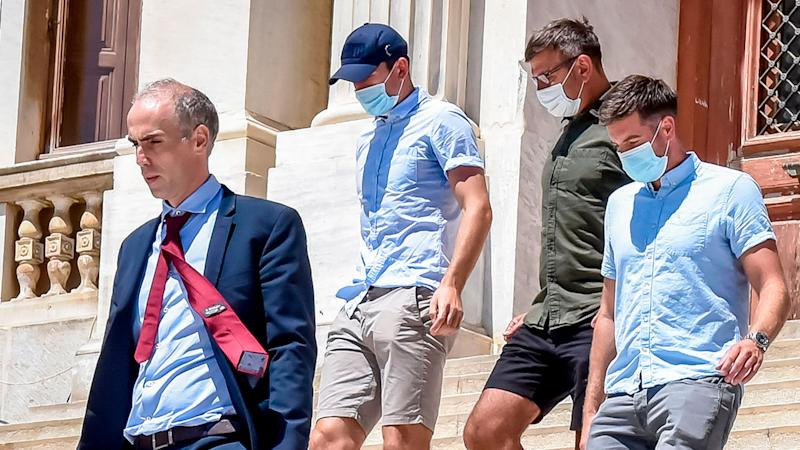 Manchester United captain Harry Maguire (centre) is seen here leaving a Greek court.