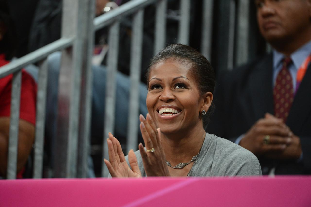 The First Lady Michelle Obama takes in the game between the USA Mens Senior National team against France at the Olympic Park Basketball Arena during the London Olympic Games on July 29, 2012 in London, England. NOTE TO USER: User expressly acknowledges and agrees that, by downloading and/or using this Photograph, user is consenting to the terms and conditions of the Getty Images License Agreement. Mandatory Copyright Notice: Copyright 2012 NBAE (Photo by Jesse D. Garrabrant/NBAE via Getty Images)