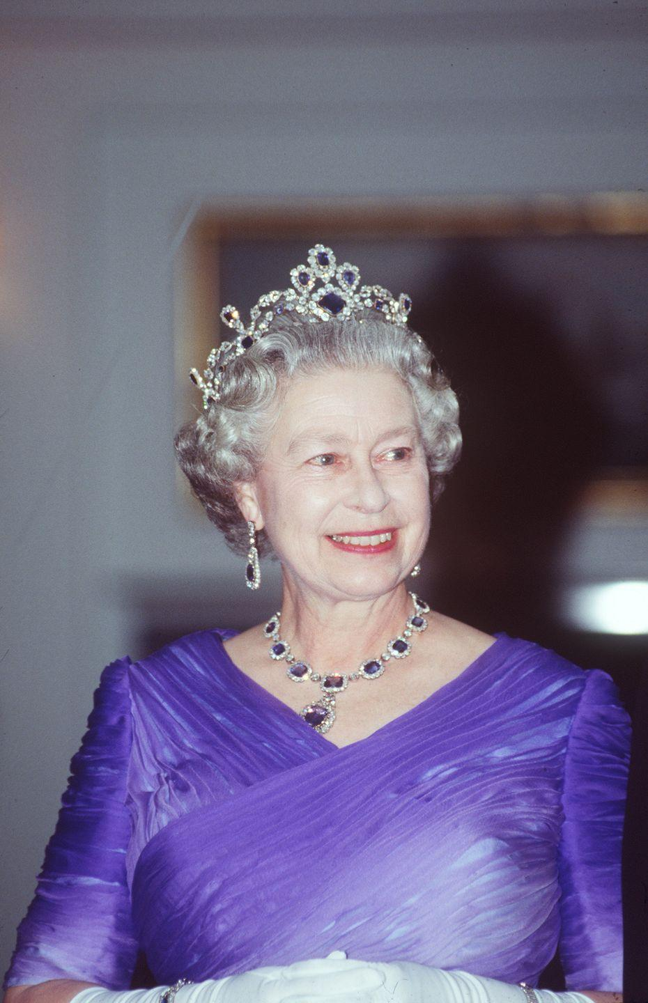 <p>In 1963, Queen Elizabeth commissioned a sapphire tiara to complement her George VI Sapphire Demi-Parure. Known as the Belgian Sapphire Tiara (the monarch wore the whole set to a banquet for the president of France in 1992, pictured here), the piece was made from an antique sapphire and diamond necklace that belonged to Princess Louise of Belgium, which the Queen had set on a frame to be exclusively worn as a tiara. </p>