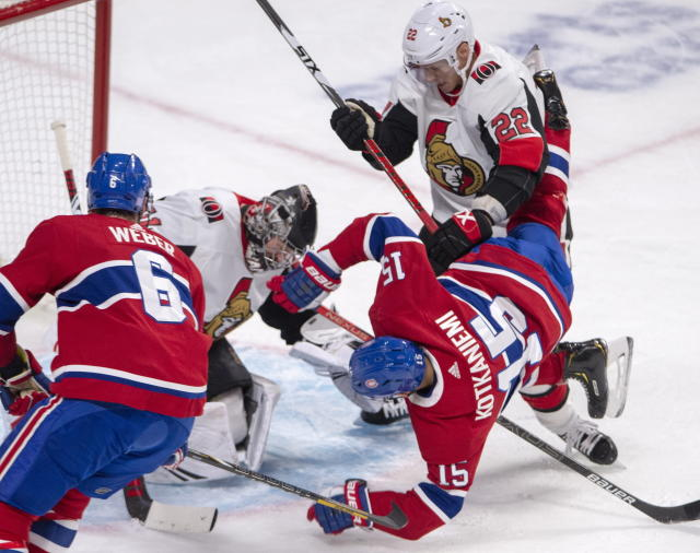 Montreal Canadiens centre Jesperi Kotkaniemi (15) is knocked to the ice by Ottawa Senators defenceman Nikita Zaitsev (22) in front of Ottawa Senators goaltender Craig Anderson (41) as Montreal Canadiens defenceman Shea Weber (6) moves in during first period NHL hockey action in Montreal, Wednesday, Nov. 20, 2019. (Ryan Remiorz/The Canadian Press via AP)