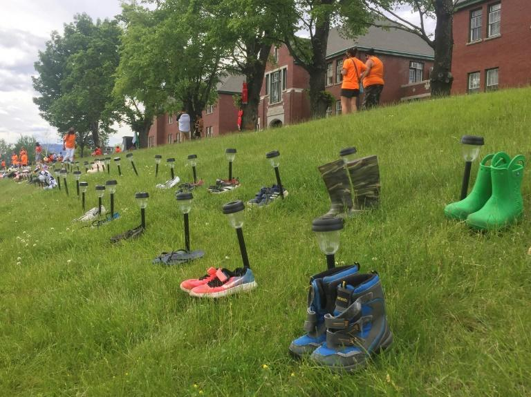 Tributes of shoes have been left at the Kamloops Indian Residential School in Kamloops, British Columbia, in memory of the 215 children whose unmarked graves were last week found on the residential school site