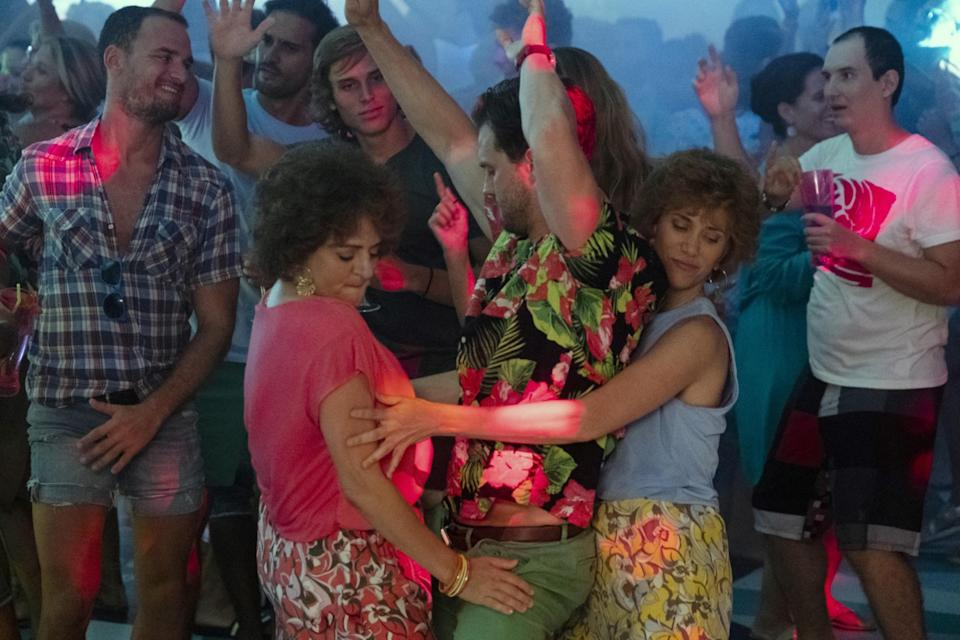 """<p>Far more bizarre than the mostly straightforward <em>Bridesmaids</em>, which Annie Mumolo and Kristen Wiig also cowrote, <em>Barb and Star</em> is about middle-aged besties who…saved a small city in Florida from the apocalypse…by getting their groove on! It's hard to explain and perhaps best experienced as a tequila-soaked surprise. Expect pastels, shells, and cameos. Who knew Jamie Dornan <a href=""""https://www.glamour.com/story/jamie-dornan-barb-and-star-go-to-vista-del-mar?mbid=synd_yahoo_rss"""" rel=""""nofollow noopener"""" target=""""_blank"""" data-ylk=""""slk:was so funny"""" class=""""link rapid-noclick-resp"""">was so funny</a>?</p> <p><a href=""""https://www.amazon.com/Barb-Star-Vista-Del-Mar/dp/B08VVJXF27"""" rel=""""nofollow noopener"""" target=""""_blank"""" data-ylk=""""slk:Available to rent on Amazon Prime"""" class=""""link rapid-noclick-resp""""><em>Available to rent on Amazon Prime</em></a></p>"""