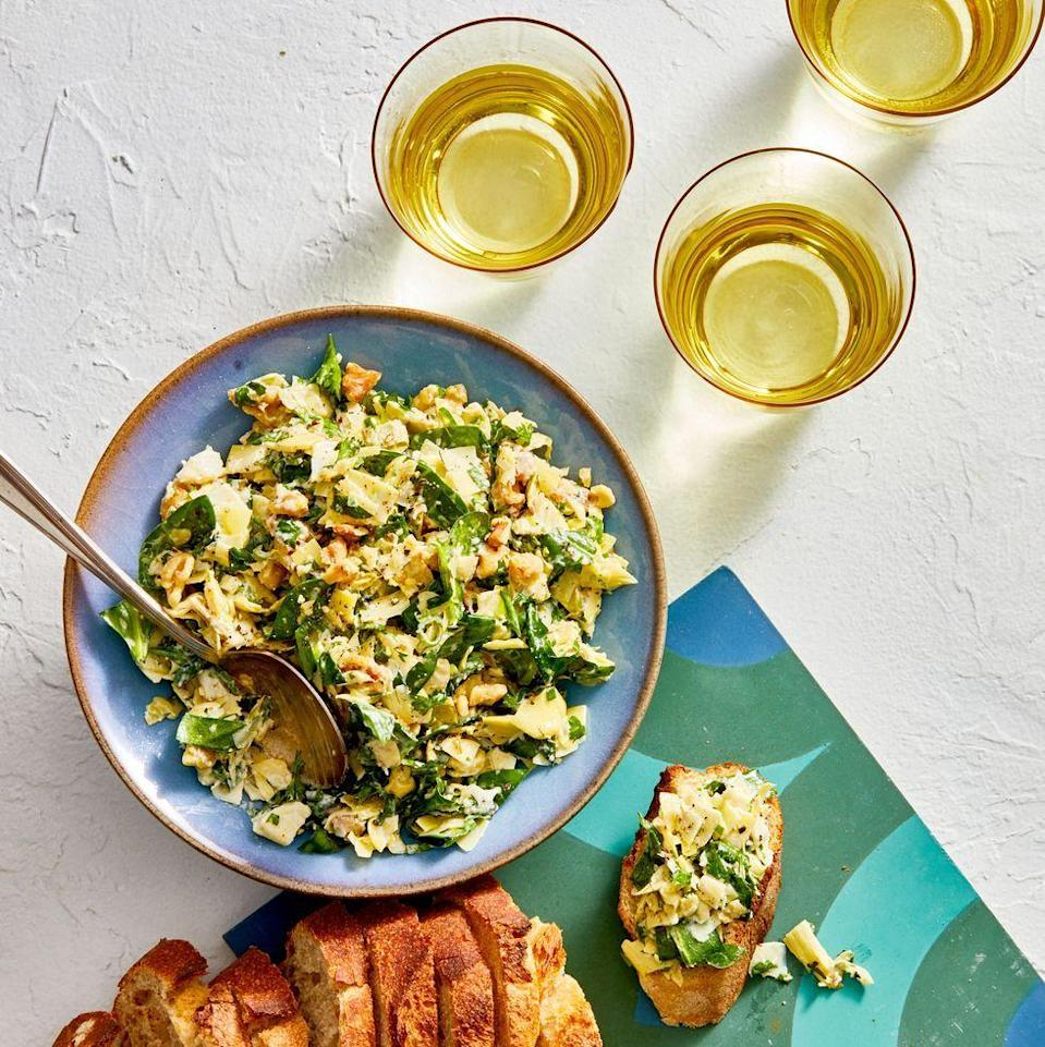 """<p>We swapped out sour cream and cream cheese for extra greens, toasted walnuts, and a bit of Parmesan for a lighter bite that's just as satisfying.</p><p><em><a href=""""https://www.goodhousekeeping.com/food-recipes/a28497576/best-ever-spinach-and-artichoke-dip-recipe/"""" rel=""""nofollow noopener"""" target=""""_blank"""" data-ylk=""""slk:Get the recipe for Spinach and Artichoke Dip »"""" class=""""link rapid-noclick-resp"""">Get the recipe for Spinach and Artichoke Dip »</a></em></p>"""