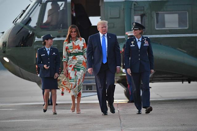 The first lady left for the U.K. in a Gucci dress paying tribute to London. (Photo: MANDEL NGAN/AFP/Getty Images)