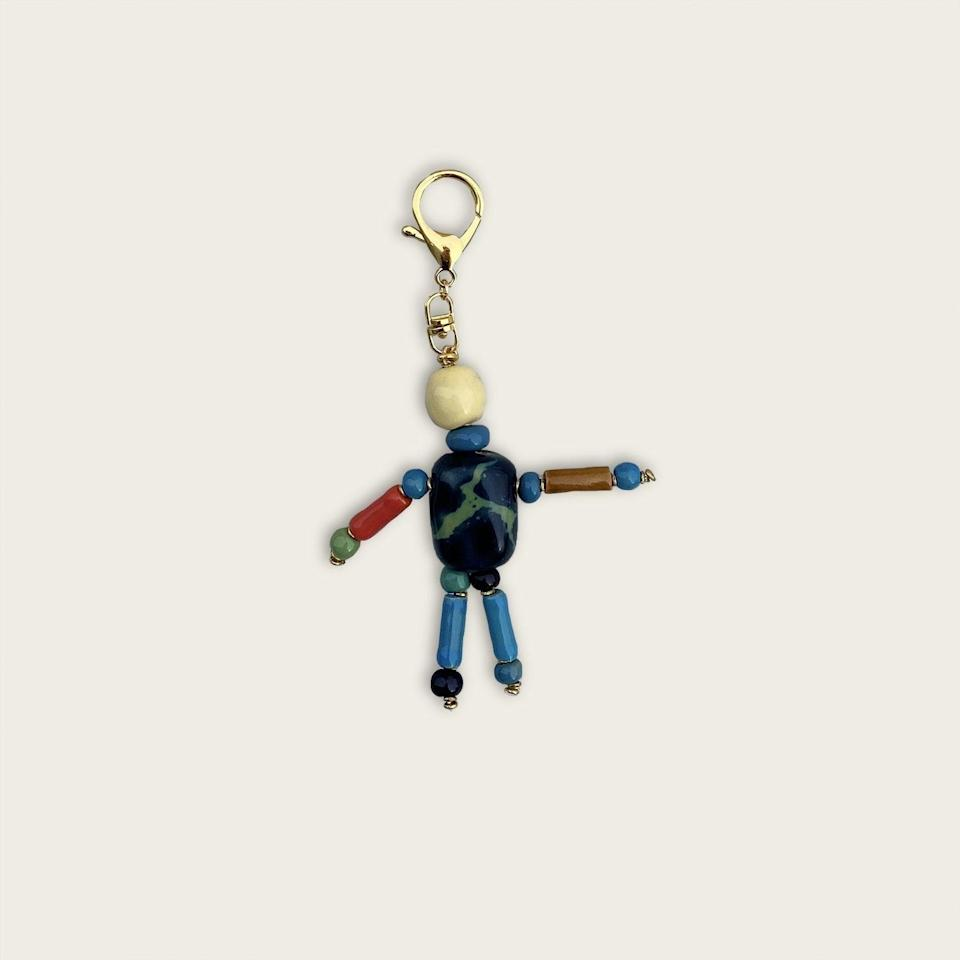 """The guy who always loses his keys might finally change his ways with this cute dancing man hanging from them. With ceramic beads hand-painted by women artisans in Nairobi, each keychain is unique and creates a positive social impact. $25, Goodee. <a href=""""https://www.goodeeworld.com/collections/all/products/dancing-keychain-green-marbled-and-yellow"""" rel=""""nofollow noopener"""" target=""""_blank"""" data-ylk=""""slk:Get it now!"""" class=""""link rapid-noclick-resp"""">Get it now!</a>"""
