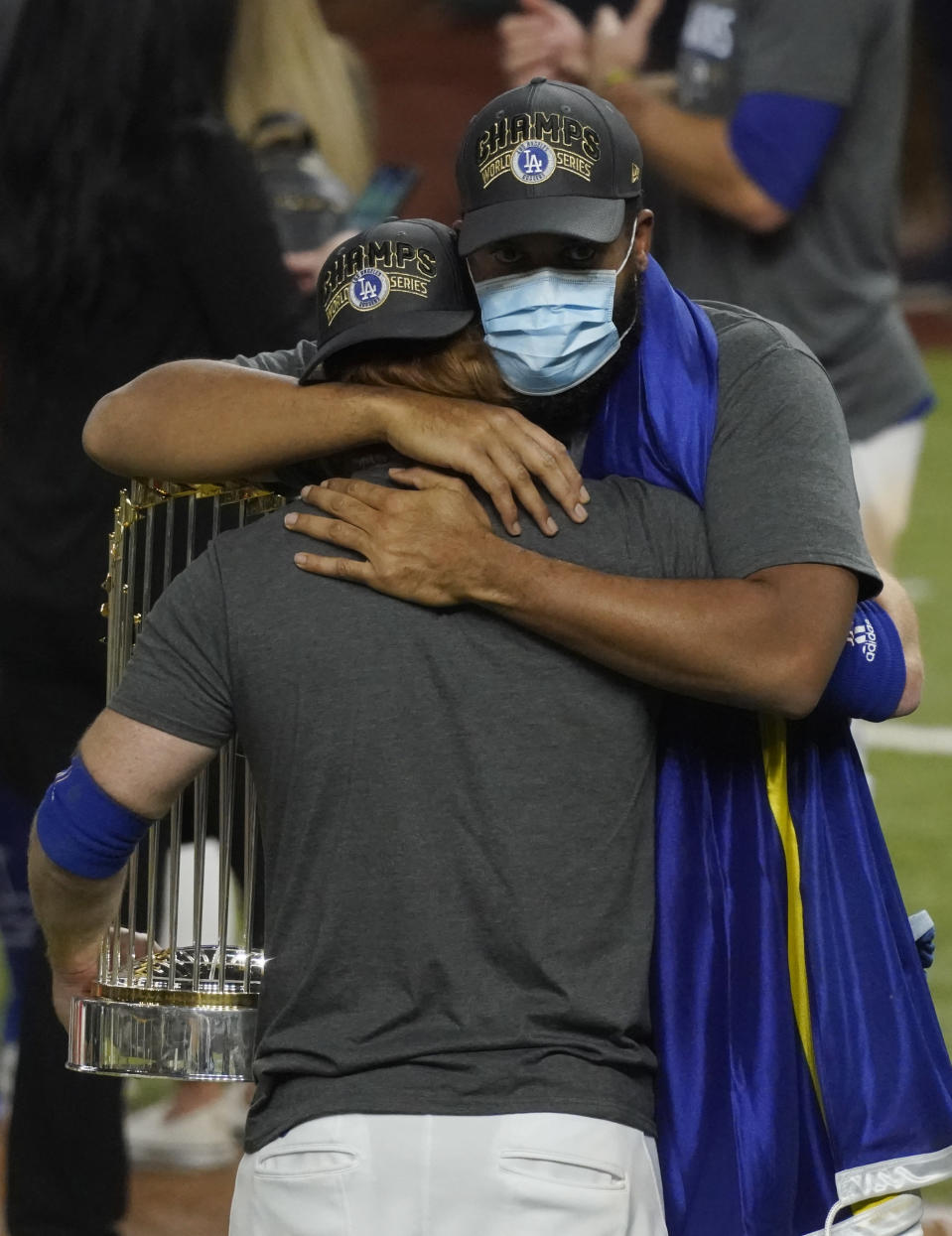 Los Angeles Dodgers third baseman Justin Turner hugs relief pitcher Kenley Jansen after defeating the Tampa Bay Rays 3-1 to win the baseball World Series in Game 6 Tuesday, Oct. 27, 2020, in Arlington, Texas. (AP Photo/Tony Gutierrez)