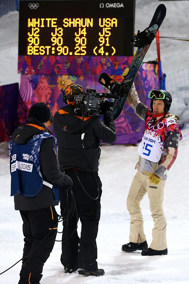 SOCHI, RUSSIA - FEBRUARY 11: Shaun White of the United States acknowledges the crowd after claiming fourth place in the Snowboard Men's Halfpipe Finals on day four of the Sochi 2014 Winter Olympics at Rosa Khutor Extreme Park on February 11, 2014 in Sochi, Russia. (Photo by Al Bello/Getty Images)