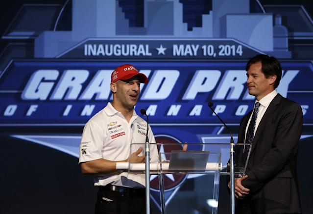 Indianapolis Motor Speedway President J. Douglas Boles, right, talks with driver Tony Kanaan, of Brazil, during an announcement of the inaugural Indianapolis Grand Prix, at Indianapolis Motor Speedway in Indianapolis, Tuesday, Oct. 1, 2013. The IndyCar event will be held May 8-10, 2014, on the reconfigured road course, two weekends before the Indianapolis 500. (AP Photo/Michael Conroy)