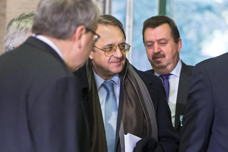 Russian deputy Foreign Ministers Mikhail Bogdanov, center, arrives for a meeting with UN Joint Special Representative for Syria Lakhdar Brahimi and U.S. Under Secretary of State for Political Affairs Wendy Sherman, to find a politic solution to the crisis in Syria, at the European headquarters of the United Nations, in Geneva, Switzerland, Monday, Nov. 25, 2013. (AP Photo/Keystone, Salvatore Di Nolfi)