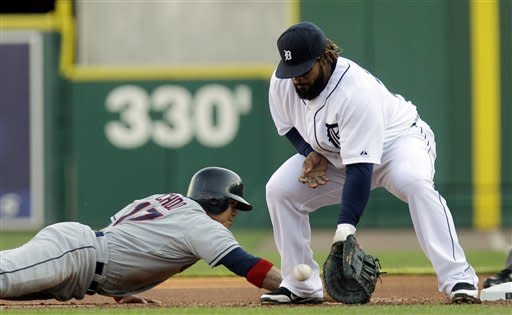 Cleveland Indians' Shin-Soo Choo (17) safely dives back to the bag under the tag of Detroit Tigers first baseman Prince Fielder during the first inning of a baseball game in Detroit, Wednesday, June 6, 2012. (AP Photo/Carlos Osorio)