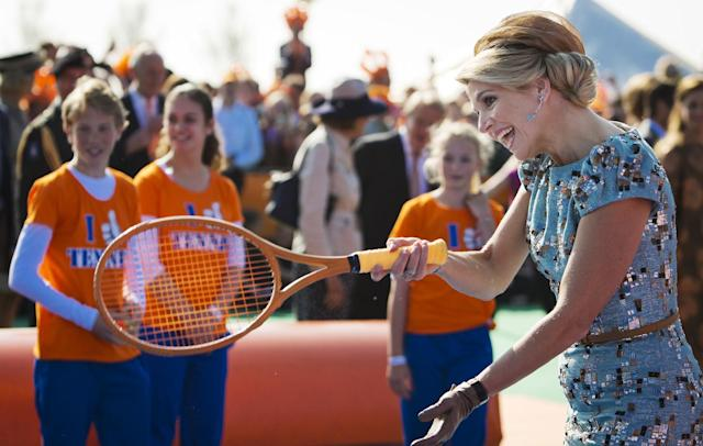 Queen Maxima, right, plays tennis during festivities marking King's Day in Amstelveen, near Amsterdam, Netherlands, Saturday, April 26, 2014. The Dutch celebrate the first ever King's Day, a national holiday held in honor of the newly installed monarch, King Willem Alexander. King's Day replaces the traditional Queen's Day. (AP Photo/Freek van den Bergh, Pool)