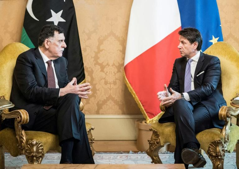 """This photo handed out on January 11, 2020 by the Palazzo Chigi Press Office shows Italian Prime Minister Giuseppe Conte (R), who said Italy would make an """"increased effort"""" to have a greater EU involvement in attempts at de-escalation in Libya"""