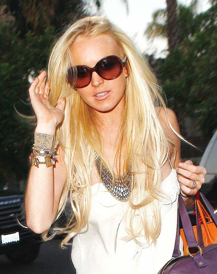 """Is it just us, or do Lindsay Lohan's extended locks and platinum shade look completely ridiculous? <a href=""""http://www.x17online.com"""" target=""""new"""">X17 Online</a> - July 30, 2009"""