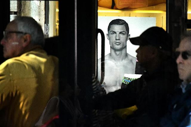 A bus drives past an advertising poster for an underwear brand, showing a picture of Cristiano Ronaldo in Rome (AFP Photo/Alberto PIZZOLI)