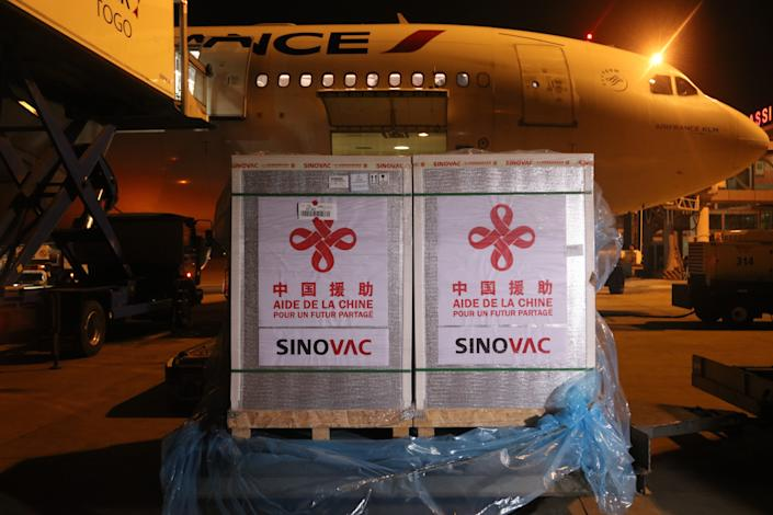 A batch of Sinovac vaccine donated by China is seen at the Gnassingbe Eyadema International Airport in Lome, Togo, Aug. 20, 2021. Togo has received the second batch of Sinovac vaccines donated by China, as part of the cooperation between the two countries to fight against the upsurge of COVID-19 cases. (Photo by Tian Yun/Xinhua via Getty Images)