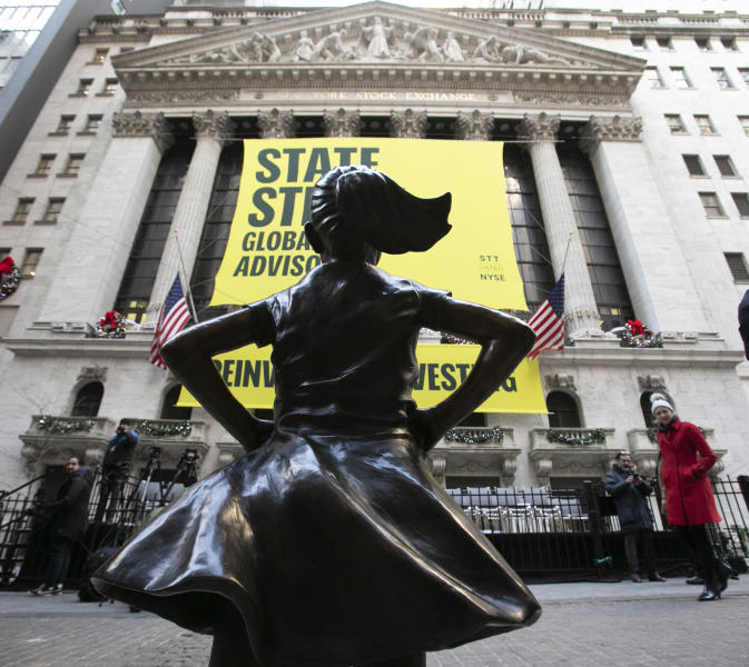 The Fearless Girl statue is unveiled at its new location in front of the New York Stock Exchange, Monday, Dec. 10, 2018, in New York. The statue, considered by many to symbolize female empowerment, was previously located near the Charging Bull statue on lower Broadway. (AP Photo/Mark Lennihan)