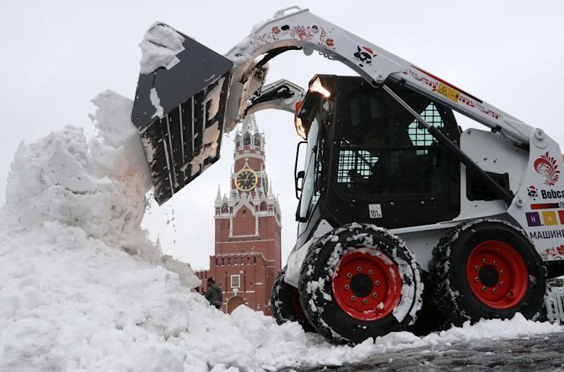 A skid steer loader clears snow in Red Square after a heavy snowstorm.