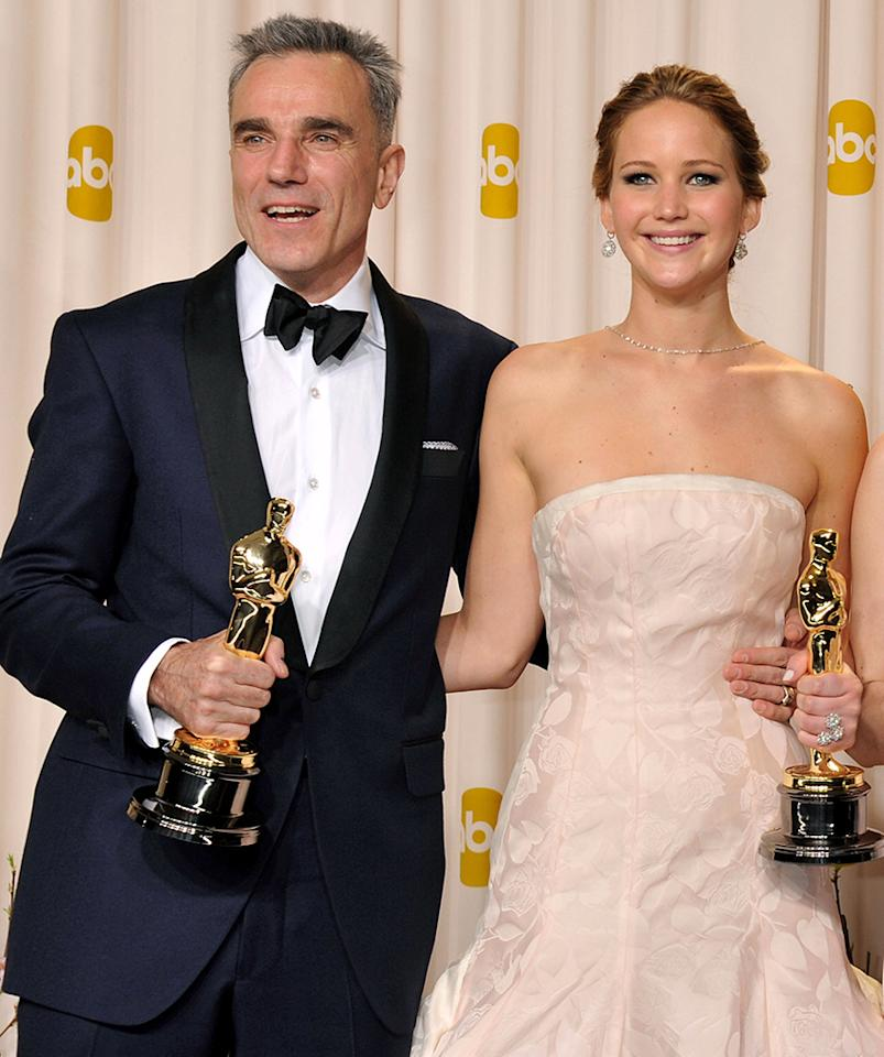 Academy Award Winners (L-R) Actor Daniel Day Lewis and Actress Jennifer Lawrence in the press room during the 85th Annual Academy Awards held at the Loews Hollywood Hotel on February 24, 2013 in Hollywood, California.  (Photo by Jennifer Graylock/FilmMagic)