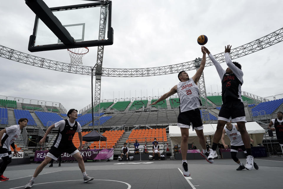Athletes compete during the Tokyo 2020 Olympic Game men's basketball 3x3 test event Sunday, May 16, 2021 at Aomi Urban Sports Venue in Tokyo. (AP Photo/Eugene Hoshiko)