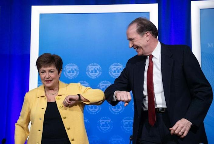 IMF Managing Director Kristalina Georgieva and World Bank Group President David Malpass bump elbows at the end of a joint press briefing on COVID-19 where they called for an all-out, coordinated global response (AFP Photo/NICHOLAS KAMM)