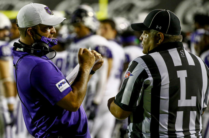 MONTGOMERY, ALABAMA - AUGUST 29: Head coach Nathan Brown of Central Arkansas talks with a referee about a call during the second half of the Guardian Credit Union FCS Kickoff football game against Austin Peay on August 29, 2020 in Montgomery, Alabama. (Photo by Butch Dill/Getty Images)