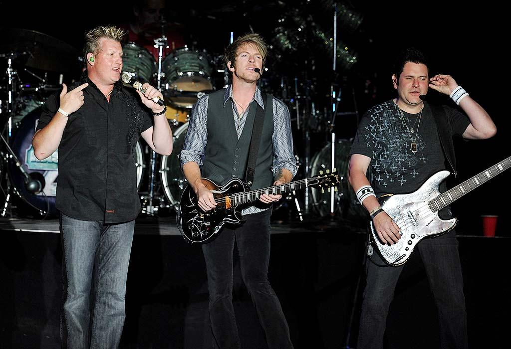 """Gary LeVox, Joe Don Rooney, and Jay DeMarcus -- better known as Rascal Flatts -- knew they'd perform a few hits on Sunday night, but they had no idea that they would end up announcing the huge news of Osama bin Laden's death to the crowd of 50,000 festival goers. """"Let's have a hand for the U.S. military,"""" said DeMarcus. """"I hope I speak for everyone here when I say 'Osama bin Laden, I hope you rest in pieces.' """" Kevin Winter/<a href=""""http://www.gettyimages.com/"""" target=""""new"""">GettyImages.com</a> - May 1, 2011"""