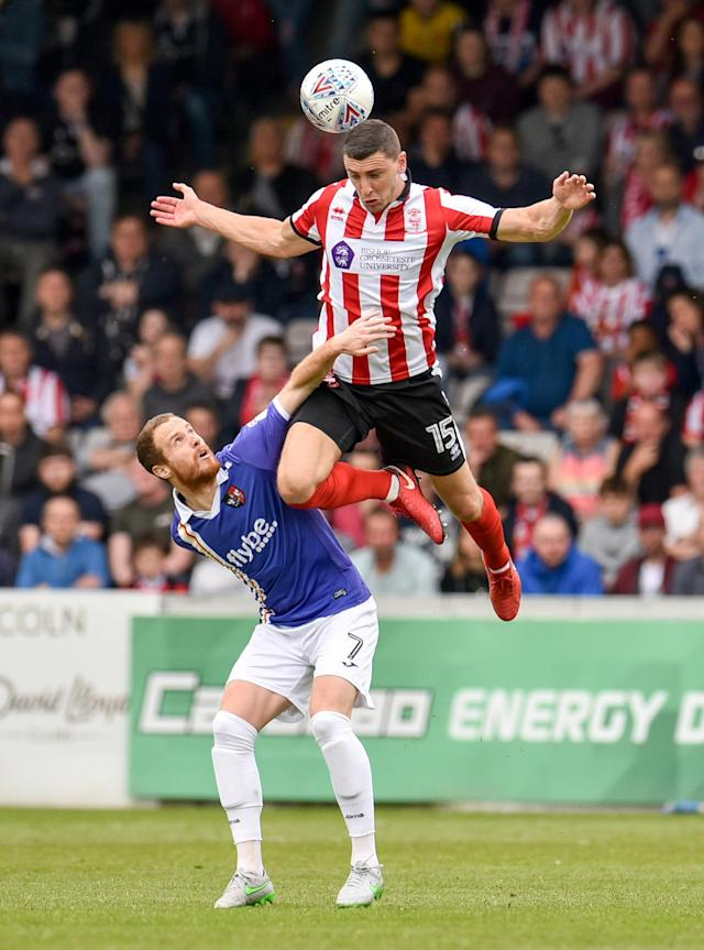 "Soccer Football - League Two Play Off Semi Final First Leg - Lincoln City v Exeter City - Sincil Bank, Lincoln, Britain - May 12, 2018 Lincoln cityÕs James Wilson in action with Exeter CityÕs Ryan Harley Action Images/Paul Burrows EDITORIAL USE ONLY. No use with unauthorized audio, video, data, fixture lists, club/league logos or ""live"" services. Online in-match use limited to 75 images, no video emulation. No use in betting, games or single club/league/player publications. Please contact your account representative for further details."