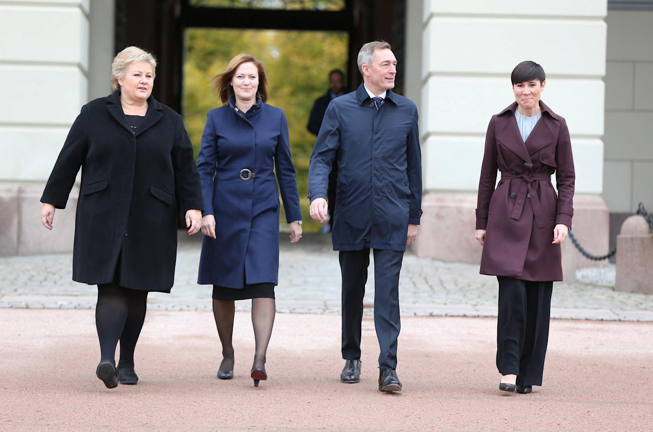Norwegian Prime Minister Erna Solberg (left) flanked by her new minister of EEA and EU Affairs, Marit Berger Roesland, Minister of Defence Frank Bakke-Jensen, Minister of Foreign Affairs Ine Eriksen Soereide pose outside of the Norwegian Castle where the new ministers where presented, in Oslo, Norway, October 20, 2017. NTB scanpix/Oern Borgen/via REUTERS    ATTENTION EDITORS - THIS IMAGE WAS PROVIDED BY A THIRD PARTY. NORWAY OUT. NO COMMERCIAL OR EDITORIAL SALES IN NORWAY.