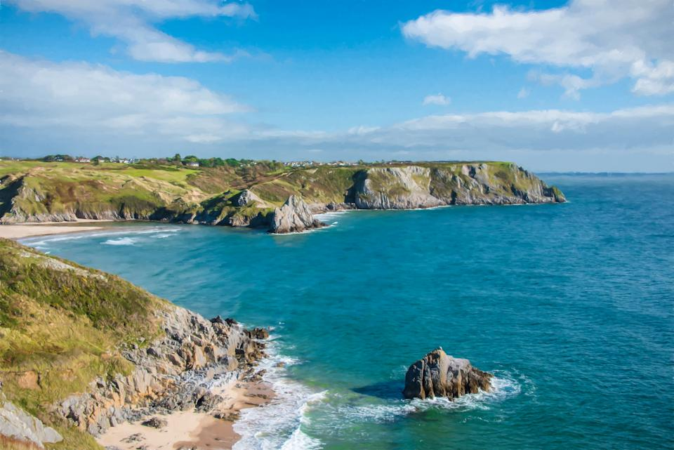 You could wake up to this beautiful view over Three Cliffs Bay on the Gower Peninsula (Getty Images)