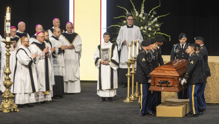 A Fort Riley honor guard places the remains of Father Emil before an alter during Kapaun's funeral mass on Wednesday, Sept., 29, 2021 in Wichita, Kan. Kapaun died in a North Korean POW camp in May of 1951. He was posthumously awarded the Medal of Honor in 2013 for his bravery in the Korean War. Kapaun's remains were identified earlier this year returned home to Kansas recently. (Travis Heying/The Wichita Eagle via AP)