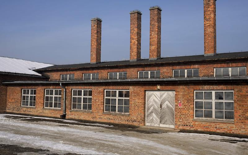 The view on the socalled 'Sauna' building in the former Nazi-German concentration and death camp KL Auschwitz-Birkenau in Oswiecim, Poland - Credit: Andrzej Grygiel/EPA