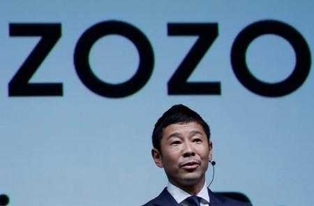 FILE PHOTO : Maezawa, the chief executive of Zozo, which operates Japan's popular fashion shopping site Zozotown and is officially called Start Today Co, speaks at an event launching the debut of its formal apparel items, in Tokyo