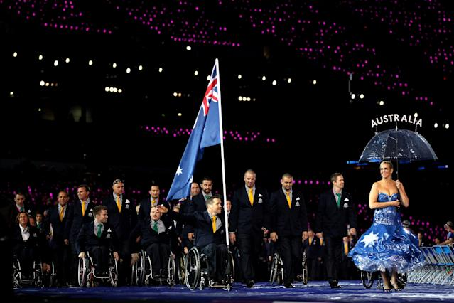 LONDON, ENGLAND - AUGUST 29: Wheelchair rugby player Greg Smith of Australia carries the flag during the Opening Ceremony of the London 2012 Paralympics at the Olympic Stadium on August 29, 2012 in London, England. (Photo by Clive Rose/Getty Images)